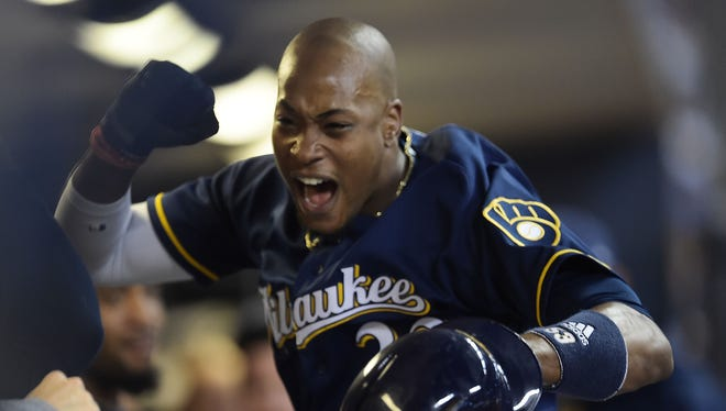 The Brewers' Keon Broxton celebrates his seventh-inning home run against the Pirates on Tuesday night.