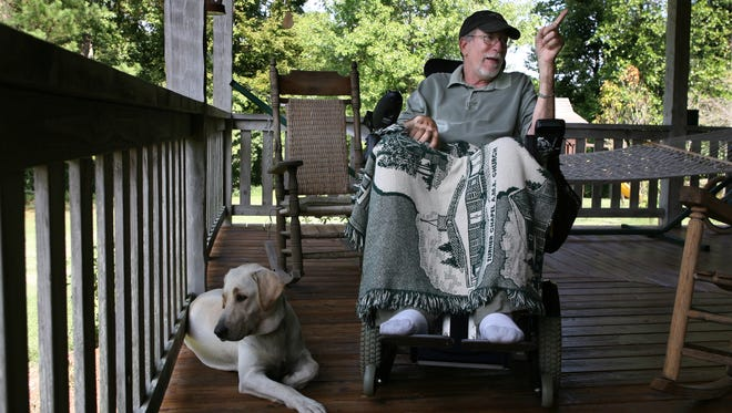 Ralph Meacham of the Garrison community has ALS (also known as Lou Gehrig's disease), but that doesn't stop him from telling stories, as he does on his front porch on Sept. 17, 2008.