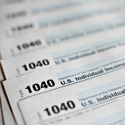 U.S. Department of the Treasury Internal Revenue Service (IRS) 1040 Individual Income Tax forms for the 2014 tax year are arranged for a photograph in Tiskilwa, Illinois, U.S., on Monday, March 16, 2015.