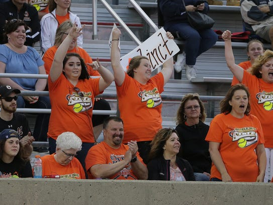 Oakfield's fans cheer for their team during their Division 5 state softball semifinal against Blair-Taylor at Goodman Diamond on Thursday night in Madison. Joe Sienkiewicz/USA Today NETWORK-Wisconsin