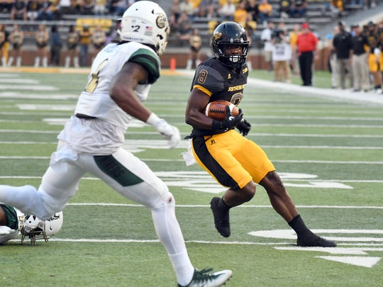 Southern Miss running back Tez Parks carries the ball