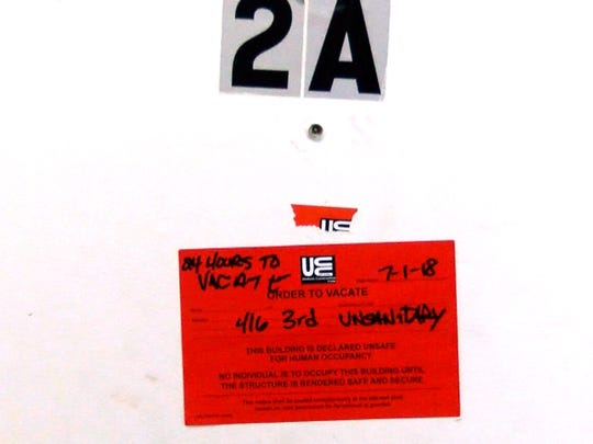 An order to vacate notice posted on one of the units at 416 3rd Street in Lakewood Tuesday, July 3, 2018.