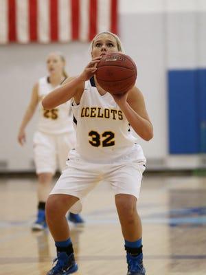 Stefani Polkowski, a Livonia Churchill alum, shoots a free throw Wednesday night for the Lady Ocelots.