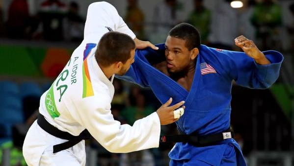Colton Brown (right) fights Alexandre Iddir of France in the men's judo 90kg round of 16 in the Rio 2016 Summer Olympic Games at Carioca Arena 2.