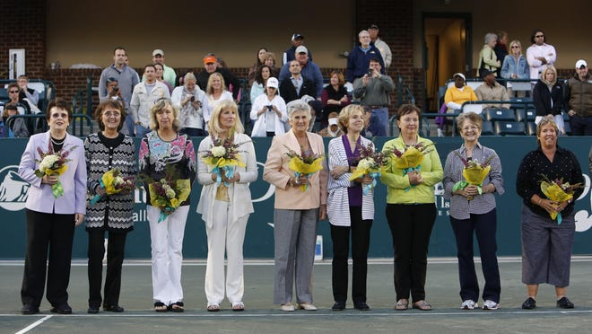 "In this April 7, 2012, file photo, members of the ""Original 9,"" from left to right, Billie Jean King, Peaches Bartkowicz, Kristy Pigeon, Valerie Ziegenfuss, Judy Tegart Dalton, Julie Heldman, Kerry Melville Reid, Nancy Richey and Rosie Casals, who helped start the women's professional tennis tour, are honored at the Family Circle Cup tennis tournament in Charleston, S.C."