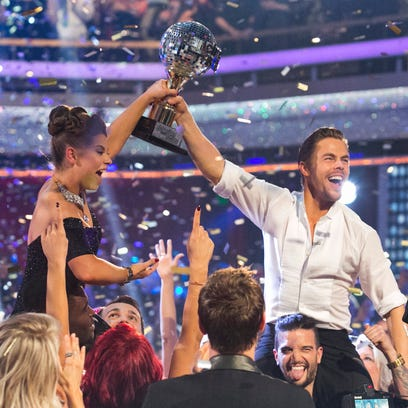 Bindi Irwin, left, and Derek Hough hold the mirrorball