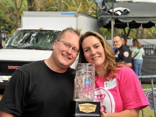 Julie Gilbert poses with her husband, Tom Gilbert,