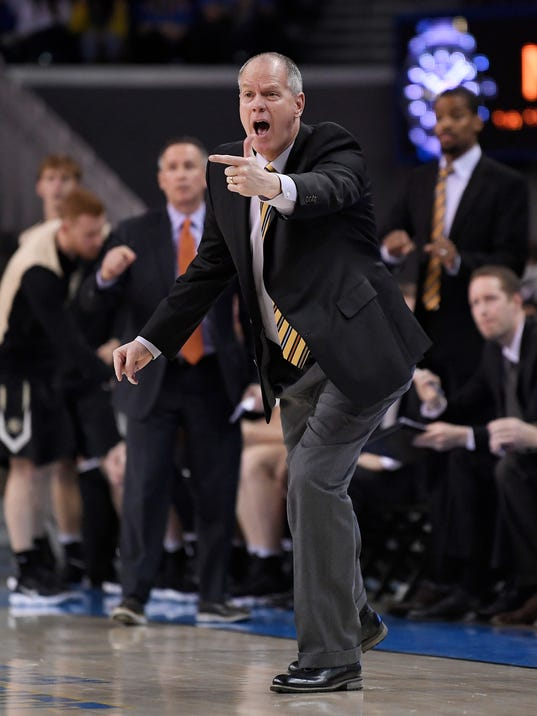 Colorado coach Todd Boyle yells to his team during the first half of an NCAA college basketball game against UCLA, Saturday, Jan. 13, 2018, in Los Angeles. (AP Photo/Mark J. Terrill)