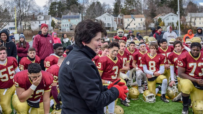 Worcester Schools Superintendent Maureen Binienda speaks to players after last November's Thanksgiving Day game between Doherty and Burncoat at Foley Stadium.