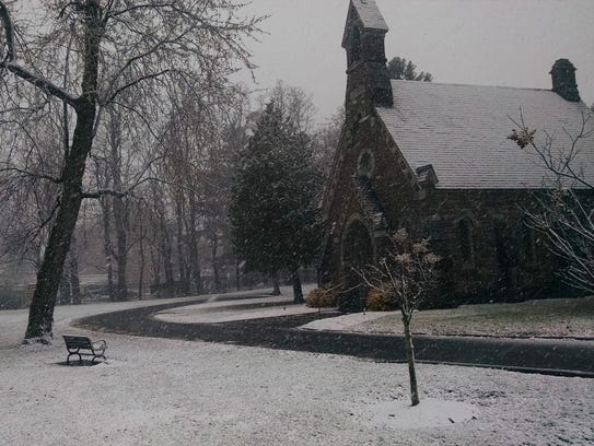 Snowfall surrounds the Louisa Howard Chapel Sunday