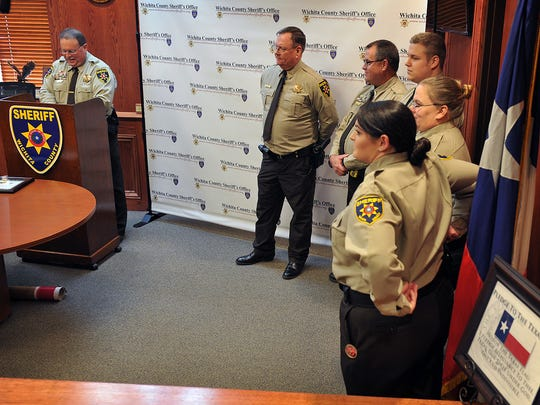 Wichita County Sheriff David Duke, left, speaks during a promotions ceremony Tuesday afternoon at the county courthouse.