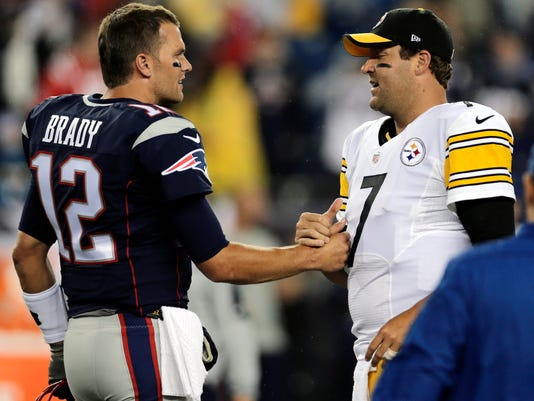 FILE - In this Sept. 10, 2015, file photo, New England Patriots quarterback Tom Brady, left, speaks with Pittsburgh Steelers quarterback Ben Roethlisberger before an NFL football game in Foxborough, Mass. So while Sunday's contest at Heinz Field will almost certainly decide the top seed in the AFC, it's not exactly Ali-Frazier, two undefeated heavyweights facing off, even with Tom Brady and Ben Roethlisberger on hand.  (AP Photo/Charles Krupa, File)