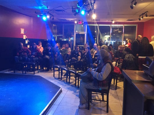 A crowd fills the seats of the Pointless Brewery & Theatre in Ann Arbor.