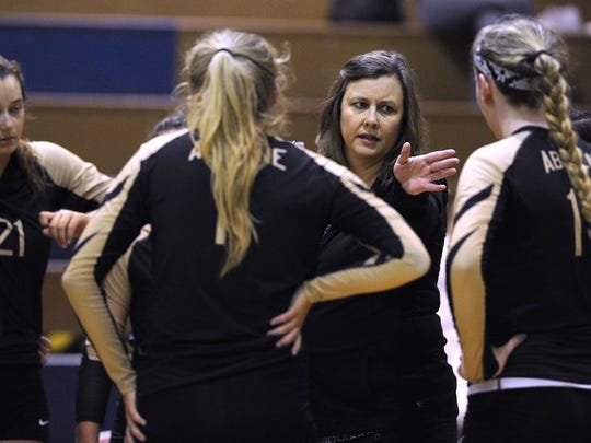 Abilene High head coach Didi Pierce talks to her players during a timeout in the Lady Eagles' win over Lubbock Coronado in the Bev Ball Classic volleyball tournament on Saturday, Aug. 13, 2016, at Cooper High School.