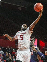 Rutgers' Mike Williams grabs a defensive rebound against