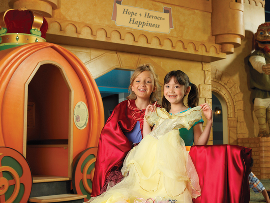 Children are pictured in the Fairty Tale Forest at The Strong.