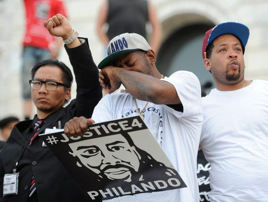 John Thompson, center a close friend of Philando Castile, becomes emotional during a protest after St. Anthony police officer Jeronimo Yanez was found not guilty on all counts in the fatal shooting of Castile in St. Paul, on June 16, 2016. EPA/CRAIG LASSIG ORG XMIT: MSP13