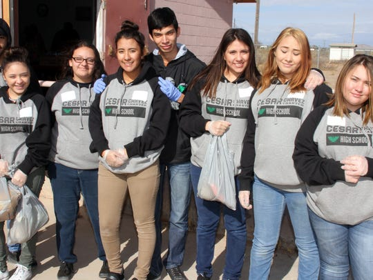Students of Deming Cesar Chavez Charter High School volunteered at the Southwestern New Mexico Transition Center on Wednesday to help package and load food baskets for veterans and their families. The SWNMTC serves about 110 families once a month. The students are, from left, Joshua Lira, Destiny Franco, Alize Close, Yohana Avitia, Kevin Arcos, Evelyn Avitia, Brianna Rodriguez and Mckayla Elliott.
