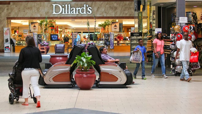 Shoppers walk to and from Dillard's at the Anderson Mall in Anderson on Thursday.