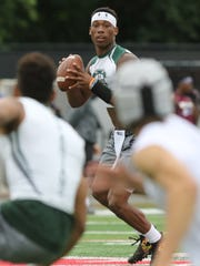 DePaul quarterback Taquan Roberson looks for a receiver as he runs the offense against Ramapo during the 7-on-7 football tournament at Rutgers University on Saturday, June 23, 2018.
