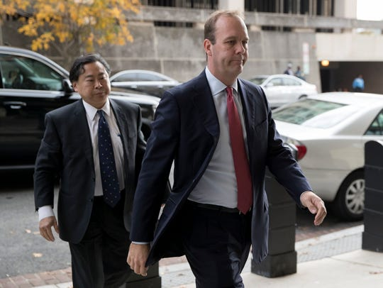 Rick Gates (R) arrives for a bond hearing at the E.
