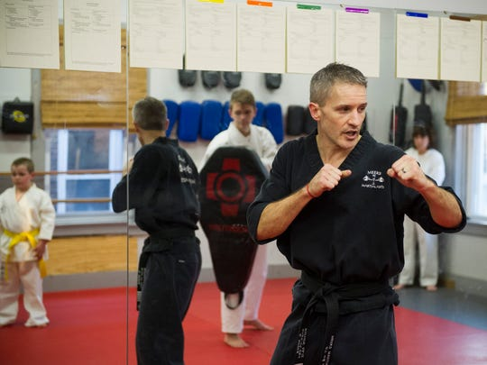 Daniel Meeks of Henderson, teaches taekwondo in his