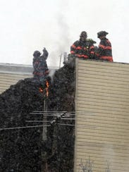 Yonkers firefighters battle a 3-alarm fire from the