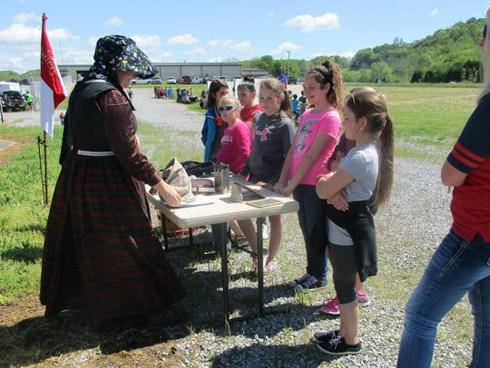 Re-enactors from different stations teach elementary