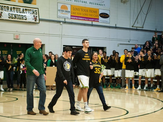 Payton Henson, second to right, walks with his mother,