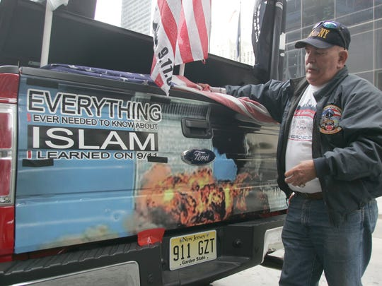 "Mark Niemczyk of Tinton Falls, seen in this 2011 file photo, used this truck to raise money for 9/11 charities. He later admitted he and a partner pocketed the $120,000 they raised for themselves. New York City  5/02/11 Reaction to the Bin Laden killing at ""Ground Zero"" the former site  of the twin towers in lower Manhatten: A first responder Mark Niemczyk of Tinton Falls, and with his memorial truck.  Tom Spader/Staff Photographer #911911"