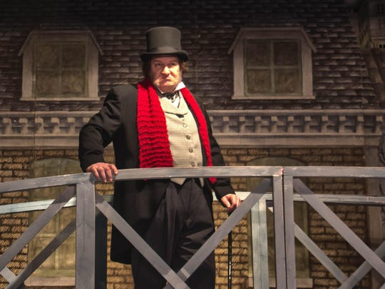 """David Spencer as Ebenezer Scrooge in New Stage Theatre's """"A Christmas Carol."""""""