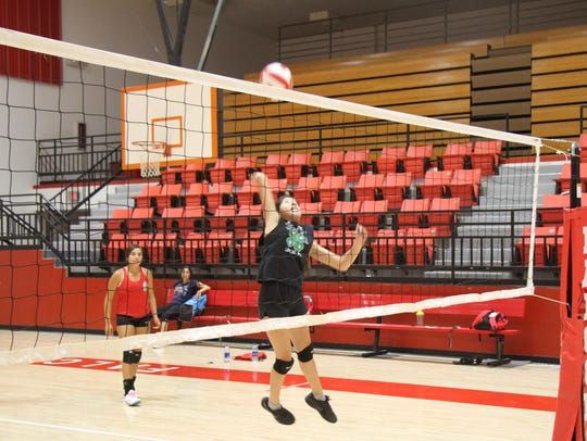 Loving's Kathryn Montoya goes for a spike during Thursday's