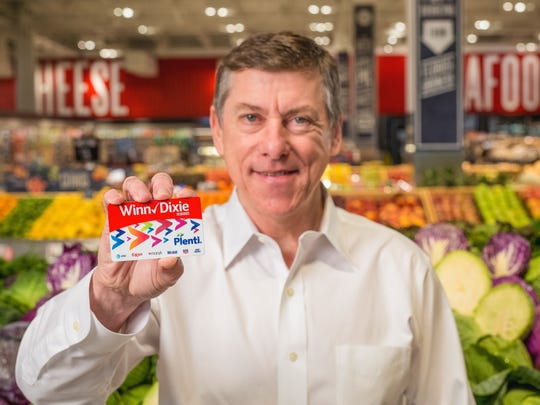 Southeastern Grocers President and CEO Ian McLeod holds a new Winn-Dixie with Plenti customer rewards card. The chain is offering the new program April 5.