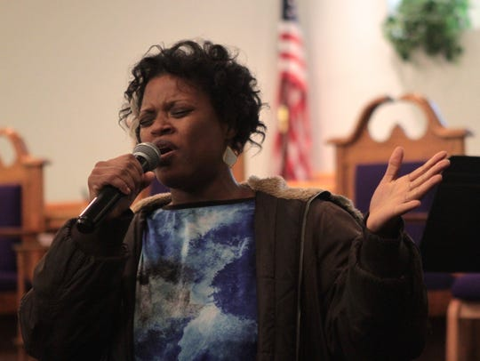 Dione Fluitt sings at an announcement ceremony for
