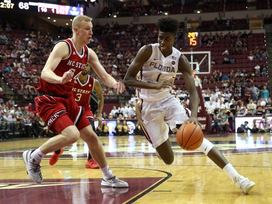 Jonathan Isaac (1) is averaging nearly 13 points and