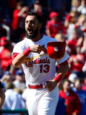 Matt Carpenter celebrates after hitting a walk off grand slam in the eleventh inning.