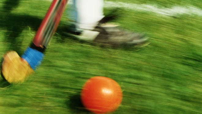 Girl playing field hockey (blurred motion)