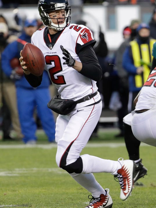 File- This Jan. 13, 2018, file photo shows Atlanta Falcons' Matt Ryan in action during the first half of an NFL divisional playoff football game against the Philadelphia Eagles in Philadelphia. The Falcons have entered the free-agency period facing financial constraints in the league's soaring market for quarterbacks. An offseason priority is reaching a new deal with Ryan, the 2016 NFL MVP who can become a free agent following his 2018 final season on his six-year, $103.75 million contract. (AP Photo/Chris Szagola, File)