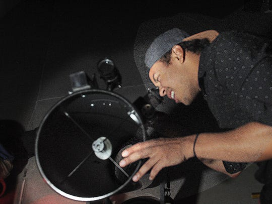 Chris Thume looks at Jupiter through a telescope at the Moorpark College Observatory. A Family Star Party will be held at the observatory on Aug. 11 so people can see the Perseid meteor shower. The event is free.