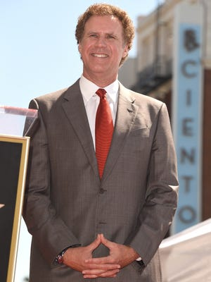 Will Ferrell poses for a photo while being honored on the Hollywood Walk Of Fame on March 24, 2015 in Hollywood, California.