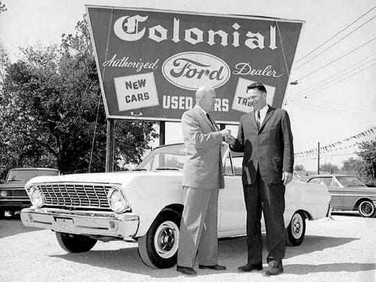 Taking the keys to a new 1964 Falcon at Colonial Ford