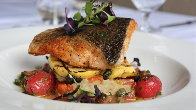 Winston in Mount Kisco is participating in  Hudson Valley Restaurant Week. This dish is from the Spring Restaurant Week menu: Seared salmon with confit tomatoes, grilled vegetables and brown butter caper sauce.