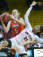 New Mexico State's Tamera William (21) looses the fight for a rebound with Texas-Rio Grande Valley's Hildur Bjorg Kjartansdottir during the third quarter of play Saturday afternoon at the Pan American Center.
