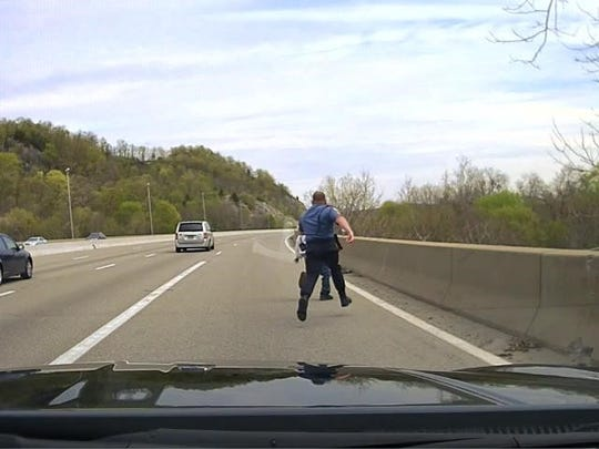 Captured on his dashcam camera, Riverdale Police Sgt. Greg Bogert chases a suicidal man attempting to jump over an overpass on Route 287 on April 27, 2016.