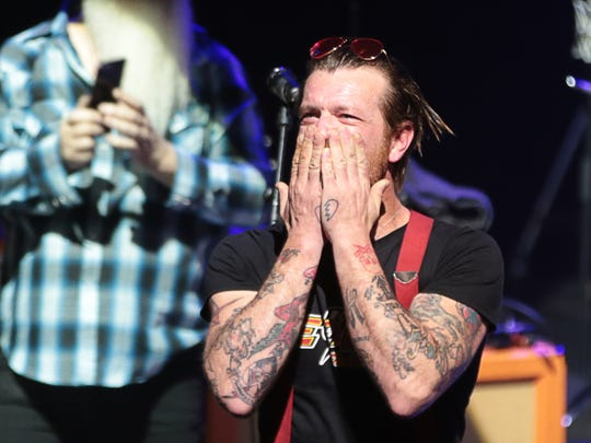 Jesse Hughes, the singer of Eagles of Death Metal, blows a kiss before the start of the concert at the Olympia concert hall in Paris, on February 16, 2016.