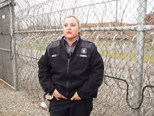 In this undated, provided photo, Michigan corrections officer Cary Johnson poses outside a state prison.