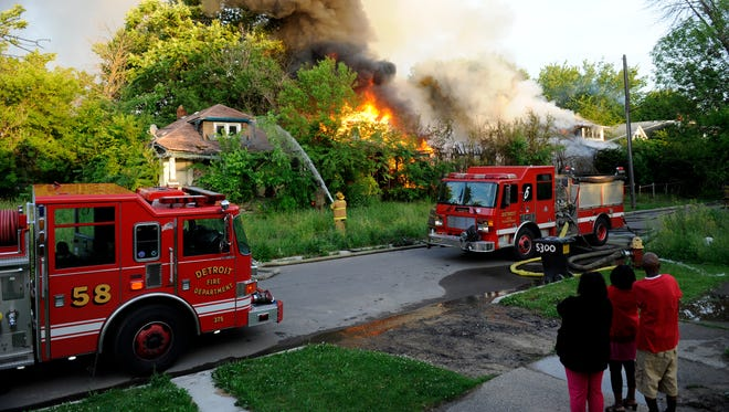 Detroit firefighters battle a blaze in a row of abandoned homes on Garland Street in Detroit.