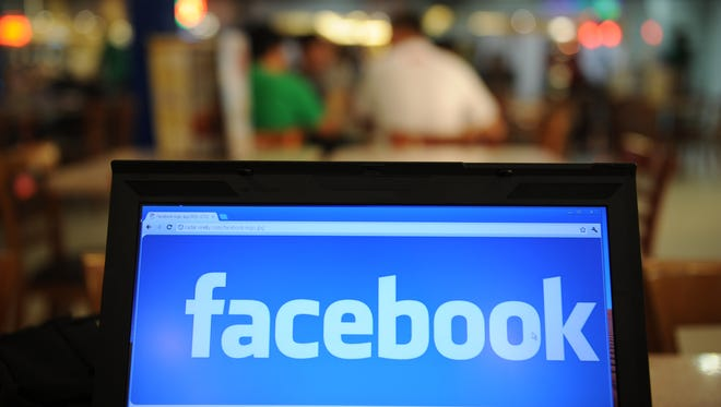 A logo of social networking Facebook is displayed on a laptop screen inside a restaurant in Manila.