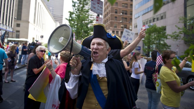 Tea party protestor Paul Johnson of Walton took part in a 2013 rally against the IRS in downtown Cincinnati.
