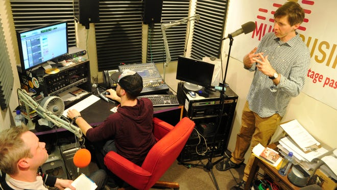 Tennessean reporter Nate Rau, Guy Fell, production at Lightning 100 and David Hooper, host of Music Business Radio at Lightning 100 record the show in Nashville, Tenn. January 20, 2015.